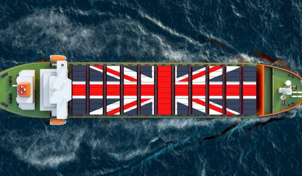 Freighter,Ship,With,British,Cargo,Containers,Sailing,In,Ocean,,3d